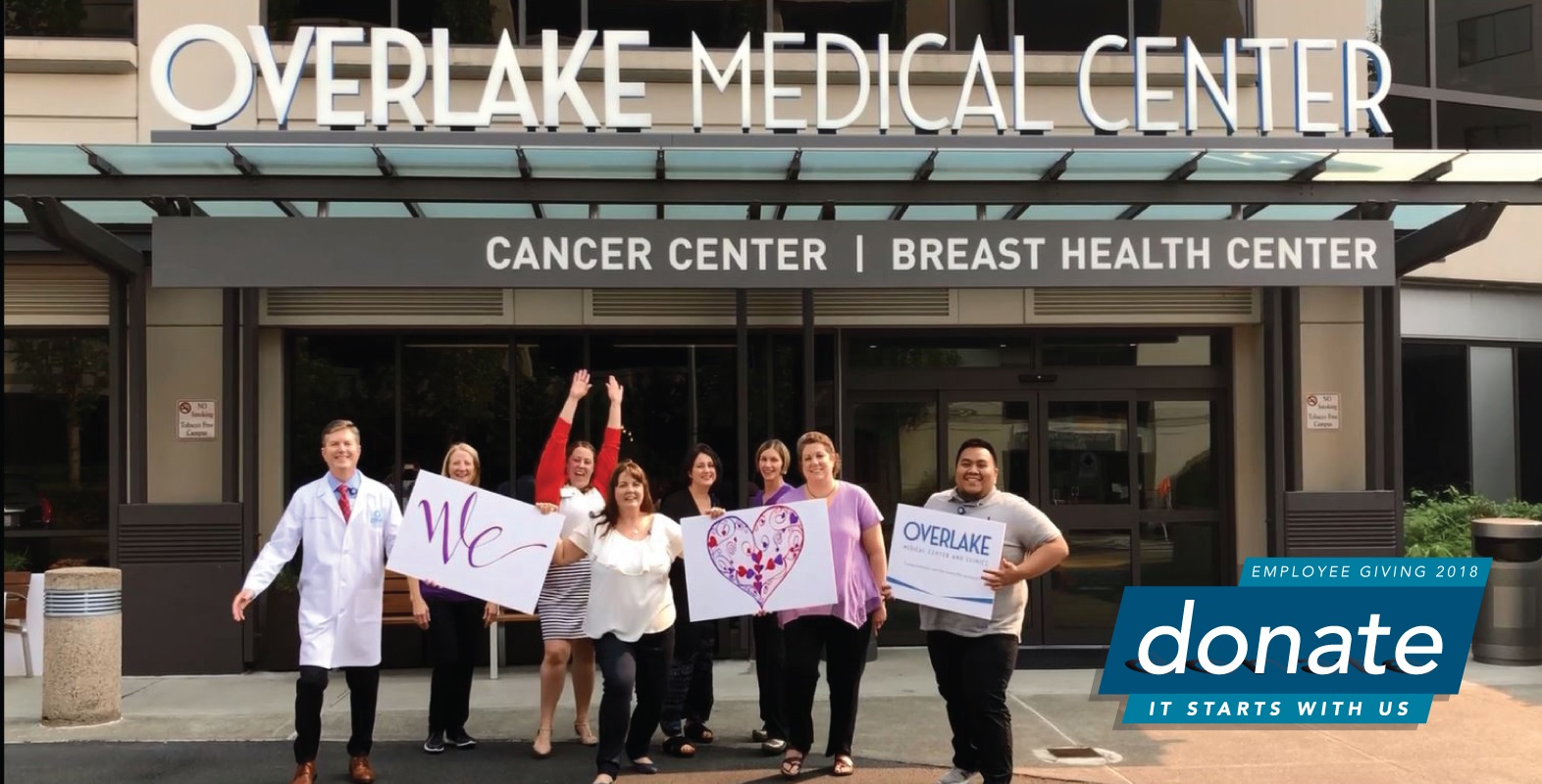 people outside the Cancer Center with Overlake signs
