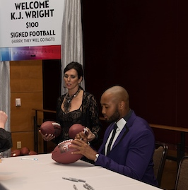 KJ Wright signing a football