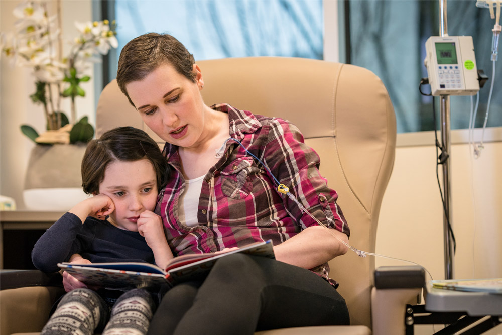 cancer patient reading to daughter