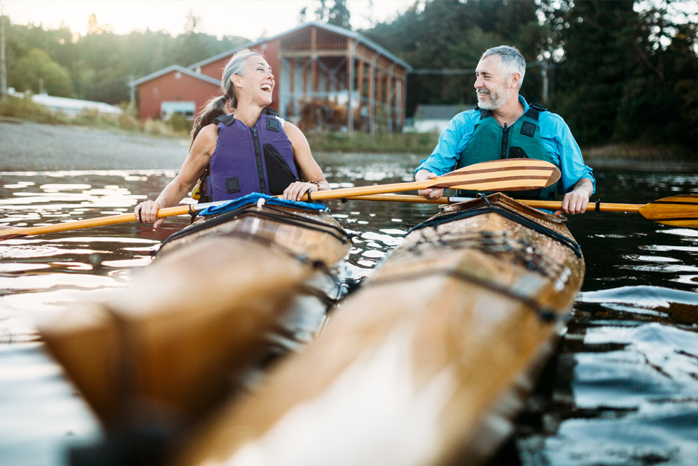 mature man and woman kayaking