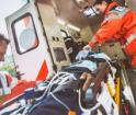 EMT's loading an injured person into an ambulance.