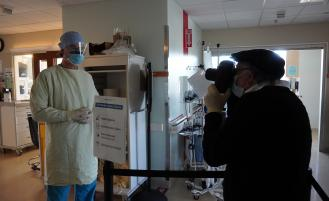 Dr. James Copeland, Critical Care, shows what equipment he uses to enter COVID-19 isolation rooms.